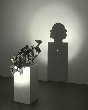 "TIM NOBLE & SUE WEBSTER, 2003 | ""A hole"" (Welded scrap metal, wood, light projector, 85 x 30.5 x 60 cm)"